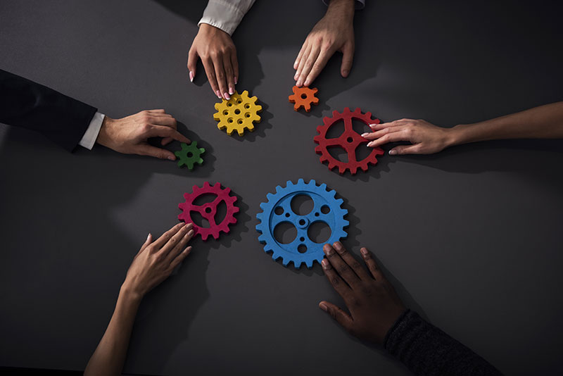 business-team-connect-pieces-gears-teamwork-partnership-integration-concept