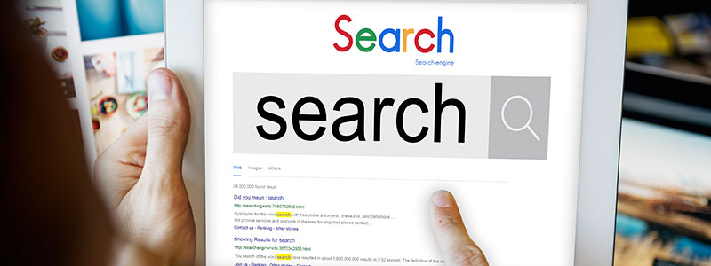 person-searching-the-web-for-services-on-ipad